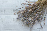 dry natural lavender branch on a wooden background - 223791017