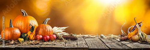 Leinwandbild Motiv Thanksgiving With Pumpkins  Corncob And Apples On Wooden Table