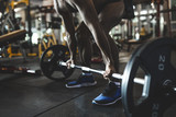 fit man make sport exercise with barbell.