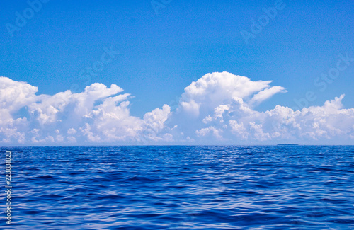 Foto Murales beautiful white clouds over the sea in similar shape