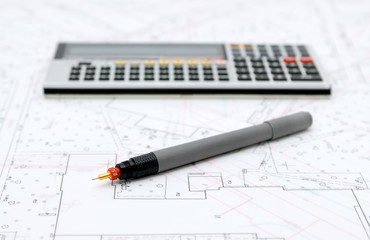 Architectural plans and drawing utensils