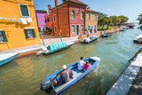Historical architecture and landmarks in Venice old town in Italy. Narrow streets with colorful buildings surrounded by tourists. Beautiful scenery of romantic canals and boats.