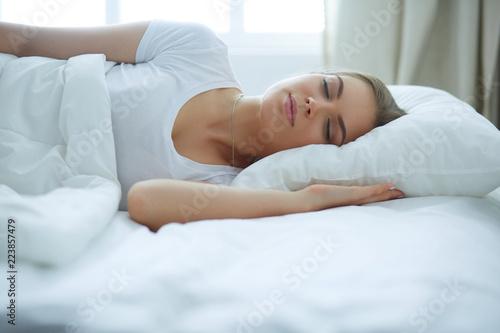 Leinwandbild Motiv Beautiful young blonde woman sleeping in bed