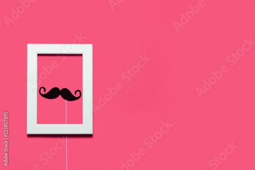Leinwandbild Motiv Frame with mustaches inside on pink background.