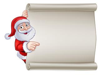 Santa Claus Christmas cartoon character peeking around and pointing at a scroll banner sign