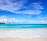 Scenic seascape with white sand on the beach and ocean's turquoise water. Idyllic tropical beach scene. Seychelles. - 223859673