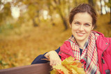 Young beautiful woman in autumn park - 223894625