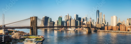 Foto Murales Brooklyn bridge and Manhattan at sunny day, New York City