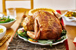 Thanksgiving turkey on dinner table with side dishes - 223924633