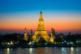 Sunset at Arun Temple or Wat Arun, locate at along the Chao Phraya river with a colorful sky in Bangkok, Thailand - 223951257