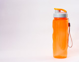 Orange water Bottle for fitness and other activities. Sports accessory isolated on white background