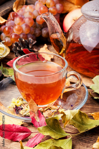 Cup of tea with autumn leaves - 223967214