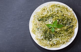plate of pasta with pesto sauce, top view - 223971034