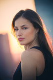 beautiful girl portrait at top of building at sunset - 223975248