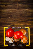 Raw tomatoes, onions and garlic on wooden table - 223988264