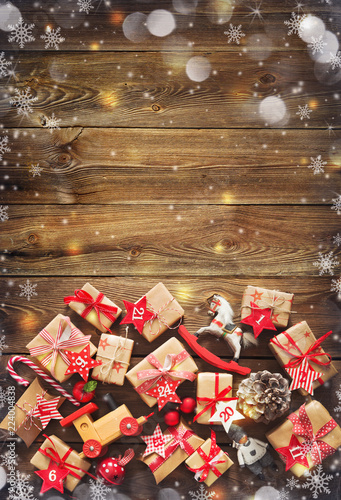 Leinwanddruck Bild Christmas background with decorations and gift boxes