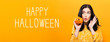Happy Halloween with young woman holding a pumpkin