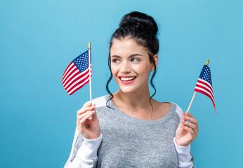 Young woman with American flag on a blue background