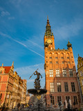 Famous Neptune fountain at Dlugi Targ square at sunrise in Gdansk, Poland.