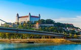 Bratislava castle over Danube river with new bridge in foreground.