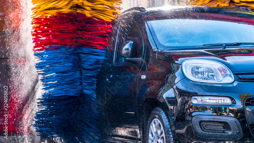 Car going through an automated car wash machine