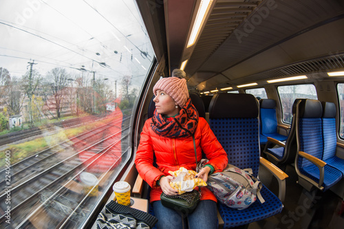 the girl is looking in window on the train