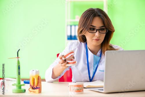 Leinwandbild Motiv Woman dentist working on teeth implant