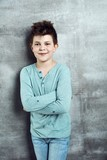Little boy standing arms crossed - 224107034