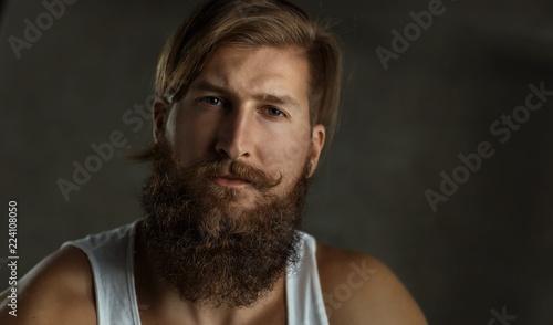 Leinwandbild Motiv Portrait of a young stylish bearded man