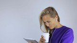 Girl drinks coffee and uses a tablet - 224111671
