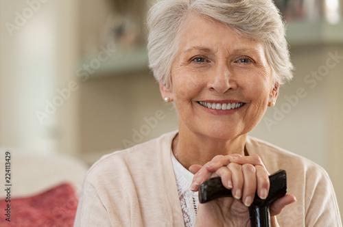 Foto Murales Elderly woman smiling at home