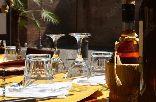Table set in a typical tavern in Italy