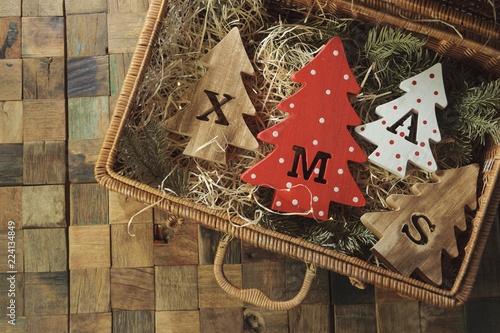 Four decorative wooden christmas trees with carved letters xmas