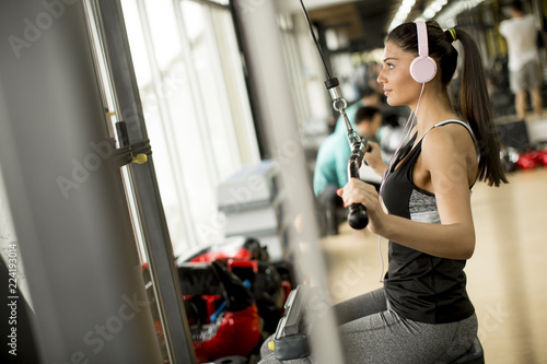 Sticker Young woman exercises in the gym