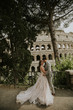 Quadro Bride and groom wedding posing in front of Colosseum, Rome, Italy
