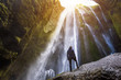 Gljufrabui waterfall in South Iceland,  adventurous traveller standing in front of the stream cascading into the gorge or canyon, hidden Icelandic landmark, inspirational landscape - 224207264