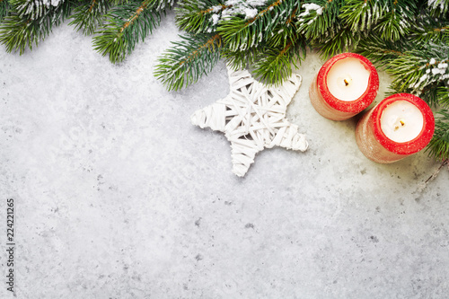 Christmas decor, candles and fir tree branch - 224221265