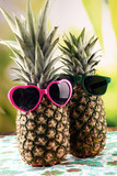 pineapple with sunglasses on patterned background. - 224230069