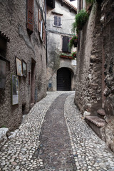 Small town narrow street view with colorful houses in Malcesine