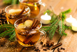 Mulled cider with cinnamon, cloves and anise. Traditional Christmas drink - 224247026