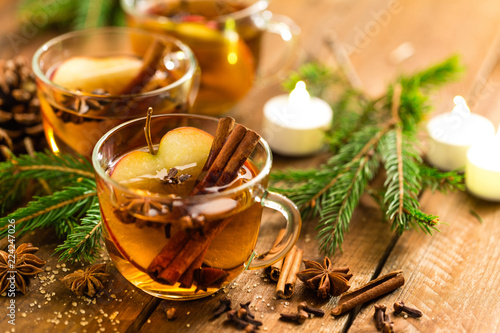 Leinwanddruck Bild Mulled cider with cinnamon, cloves and anise. Traditional Christmas drink