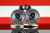 Physical version of Ethereum (ETH) and Austria Flag. Conceptual image for investors in cryptocurrency, Blockchain Technology, Smart Contracts, Personal Tokens and Initial Coin Offering. - 224309462
