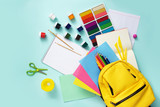 School stationary sets and knapsack on blue background. - 224310692