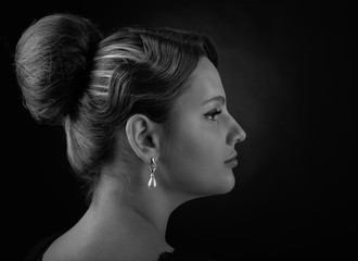 Portrait of a beautiful woman with perfect hair and  pearl earrings . © Igor Normann