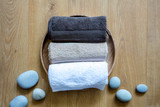pampering towels and zen stones on round natural wooden background - 224324875