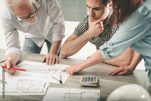 Architects working on plans - 224328842