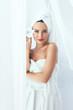 Body Skin Care. Beautiful Woman In Towel In Beauty Spa Salon