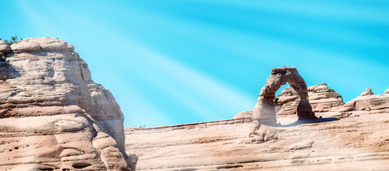 Delicate Arch against summer sky, Arches National Park, USA