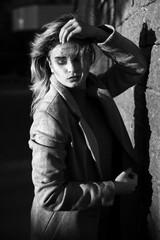 Street portrait of a girl in a coat