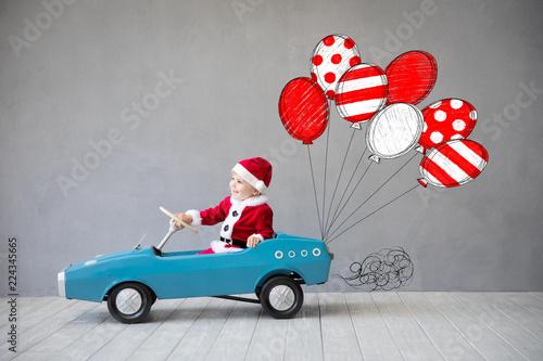 Leinwanddruck Bild Kid having fun at Christmas time